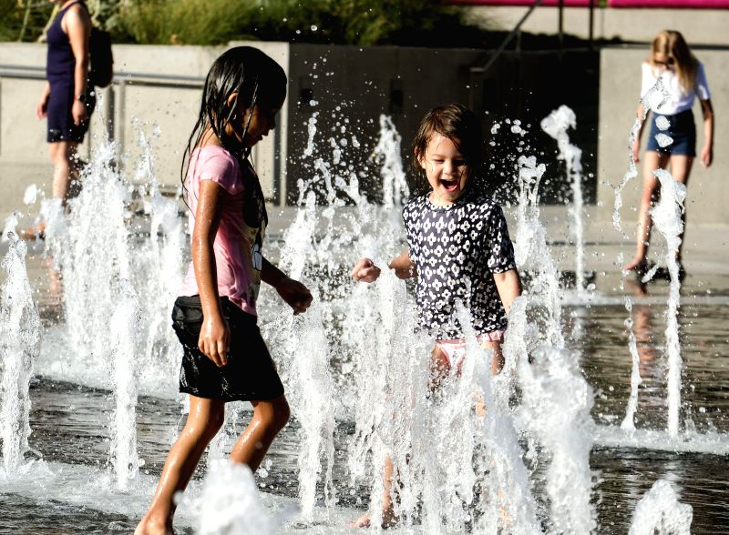LOS ANGELES, July 25, 2018 - Children cool off in the fountain at Grand park in downtown Los Angeles, the United States, July 24, 2018. Health officials issued a heat alert for Los Angeles County's ...