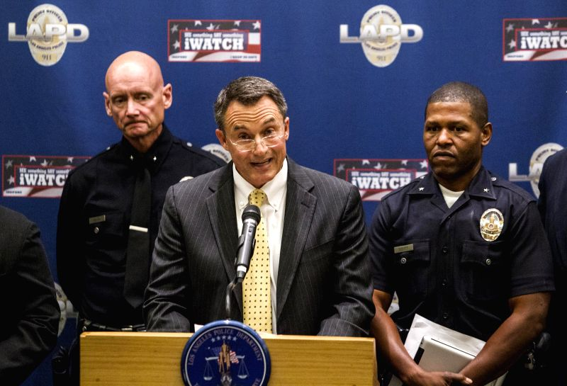 Senior officers of Los Angeles Police Department (LAPD) Andrew Smith (L) and William Scott (R) look on as University of Southern California's (USC) senior ...