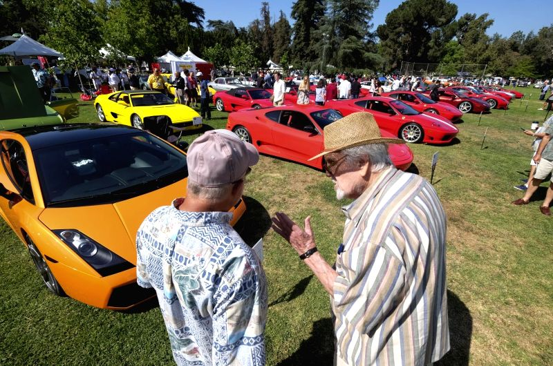 LOS ANGELES, June 11, 2018 - Visitors admire Farrari classic cars during the San Marino Motor Classic cars show in San Marino, Los Angeles, the United States, June 10, 2018.