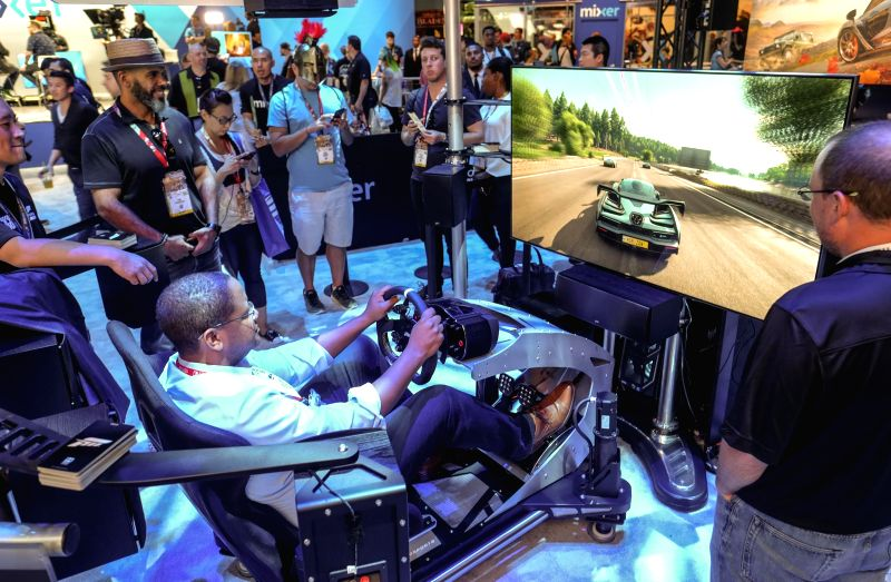 LOS ANGELES, June 13, 2018 - Gamers experience new games at the Electronic Entertainment Expo 2018 (E3 2018) held in Los Angeles, the United States, on June 12, 2018.