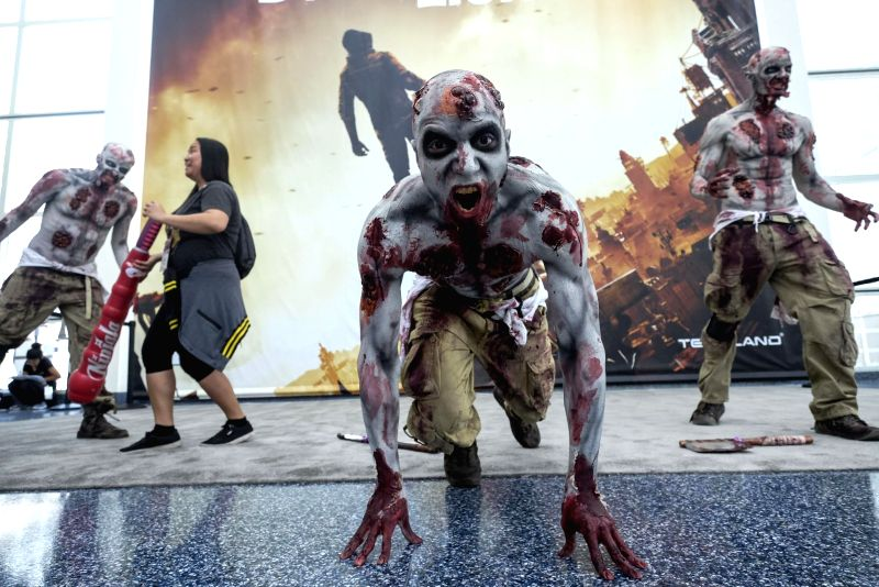 LOS ANGELES, June 13, 2018 - Zombie cosplayers perform at the Electronic Entertainment Expo 2018 (E3 2018) held in Los Angeles, the United States, on June 12, 2018.