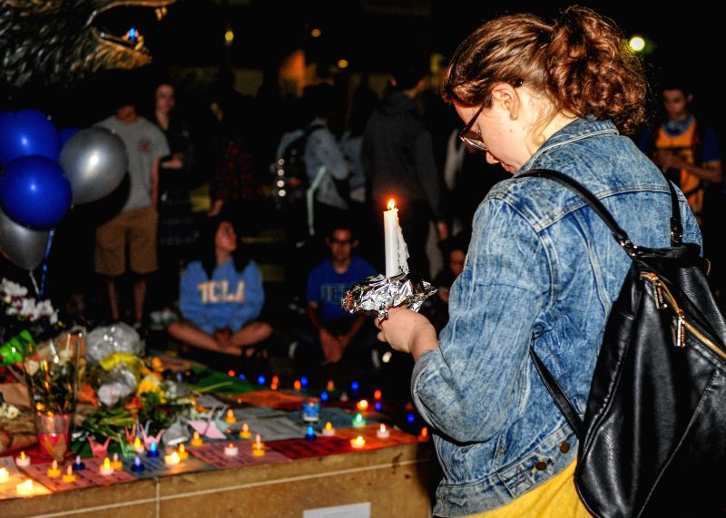 LOS ANGELES, June 3, 2016 - A student mourns the shooting victim at the University of California, Los Angeles (UCLA), in Los Angeles, the U.S., on June 2, 2016. More than a thousand teachers and ...
