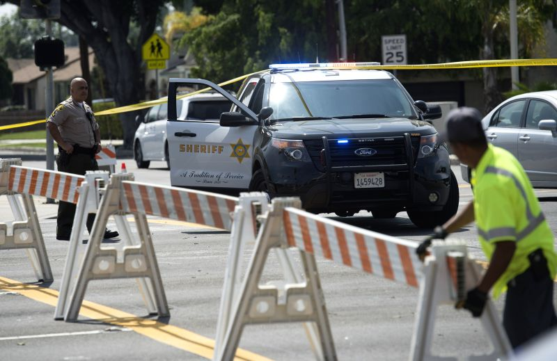 LOS ANGELES, March 20, 2017 - Police block the road near the site of a shootout outside a Los Angeles County sheriff's station, the United States, on March 20, 2017. An armed man died in a shootout ...