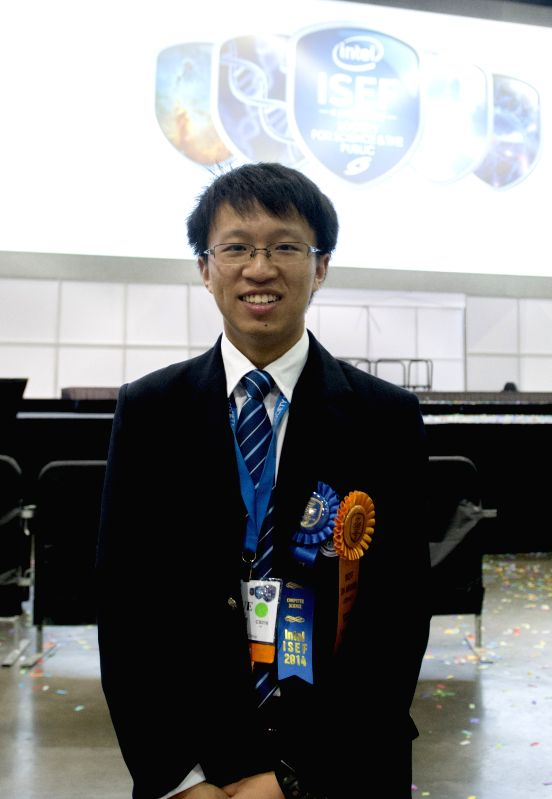 Intel ISEF Best of Category Awards winner Yao Yue from China poses for photos during the award ceremony of Intel International Science and Engineering Fair ...