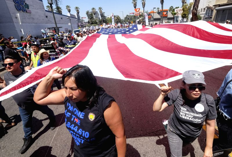 LOS ANGELES, May 2, 2017 - Protesters participate in a May Day march in Los Angeles, the United States, May 1, 2017. Thousands of Americans on Monday took to streets in major U.S. cities including ...