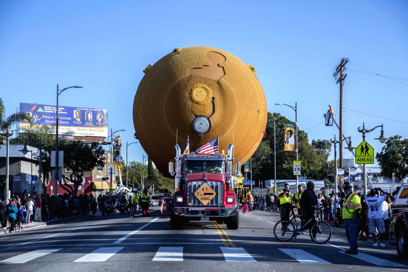 LOS ANGELES, May 22, 2016 - The space shuttle fuel tank ET-94 is transported through Vermont Avenue in Los Angeles, the United States, on May 21, 2016. ET-94 is about 47 meters long and 8.382 meters ...