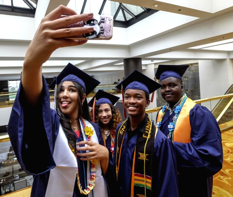 LOS ANGELES, May 28, 2017 - Students of American University Preparatory School take selfie after a graduation ceremony at a hotel in downtown Los Angeles, the United States, May 27, 2017.