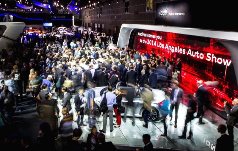 Los Angeles: Media members crowd as the Audi presents their new cars during the media preview day at the 2014 Los Angeles Auto Show in Los Angeles, on Nov. 19, 2014.