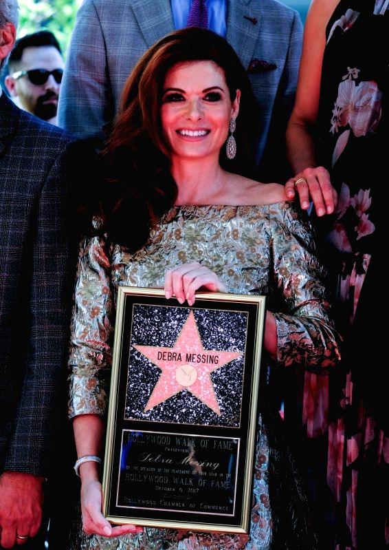 LOS ANGELES, Oct. 7, 2017 - Actress Debra Messing poses after receiving a star on the Hollywood Walk of Fame in Los Angeles, the United States, on Oct. 5, 2017. - Debra Messing