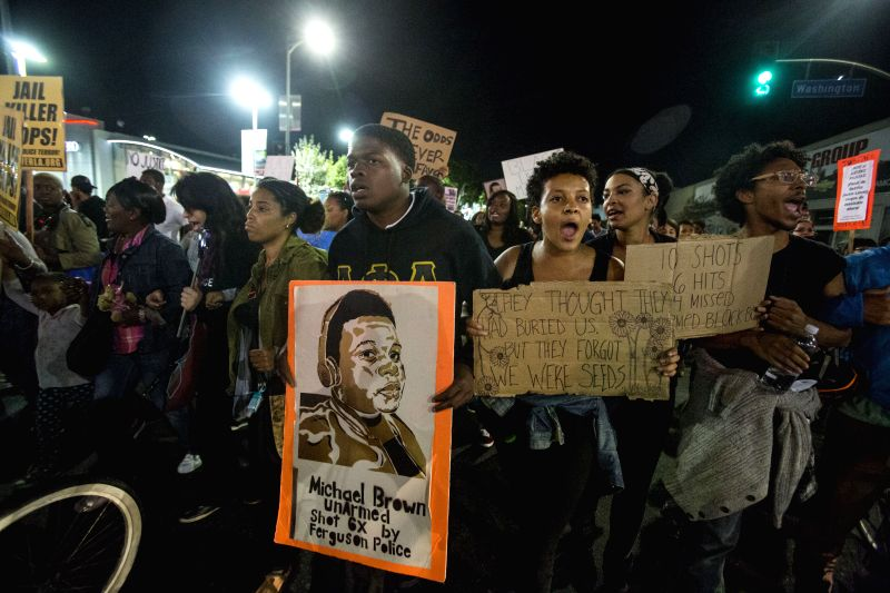 Los Angeles (United States): Demonstrators march on the street during a protest in Los Angeles, United States, on November 25, 2014. Thousands of people in Washington, New York, Boston and a dozen of