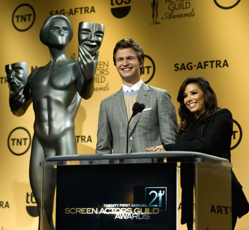 Los Angeles (US): Actors Ansel Elgort (L) and Eva Longoria announce the nominees for the 21st Screen Actors Guild (SAG) Awards in Los Angeles, the United States, Dec. 10, 2014. - Ansel Elgort and Guild