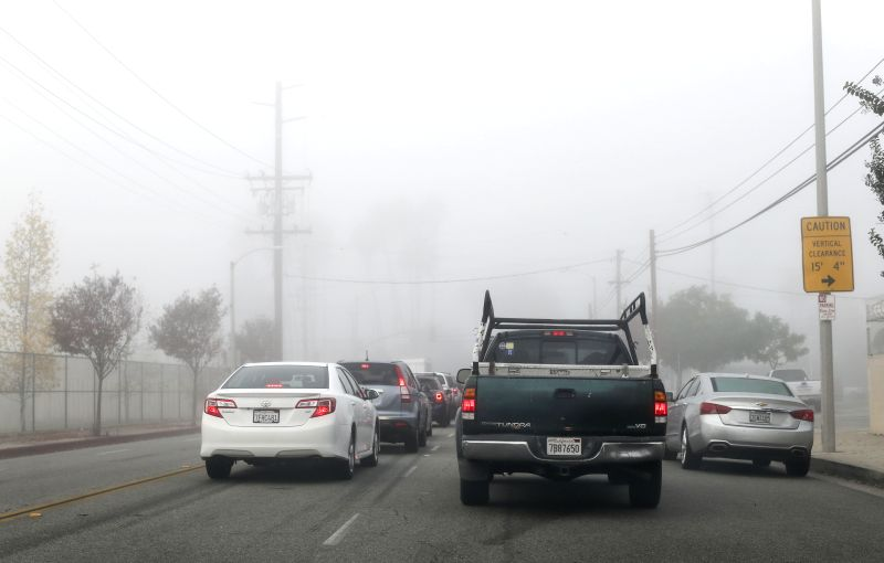 Los AngelesTraffic makes its way through dense fog near downtown Los Angeles, the United States, Dec. 10, 2015. Commuters are being warned of potentially dangerous driving conditions on freeways ...