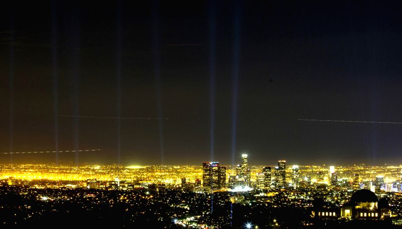 The spotlights along the marathon route are seen from the Griffith Park Observatory in Los Angeles on March 13, 2015. Totally 124 spotlights were set along the ...