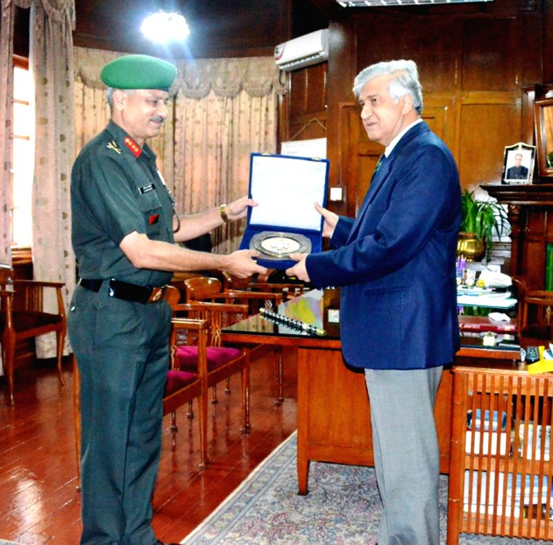 Lt Gen A Chakravarty, VSM, DG NCC calls on Dr. KK Paul, Governor of Meghalaya at Raj Bhawan in Shillong on Aug 6, 2014.