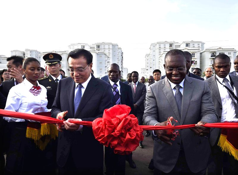 Photo: Chinese Premier Li Keqiang (L, front) and Angolan Vice President Manuel Vicente (R, front) cut the ribbon at the opening ceremony of a vocational school ...
