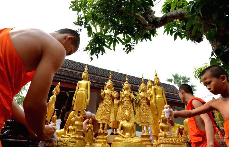 LUANGPRABANG, April 14, 2018 - Buddhist monks clean and wash Buddha statues during the Songkran Water Festival celebrations at the Sensoukaram Temple in Luang Prabang, Laos, April 14, 2018.