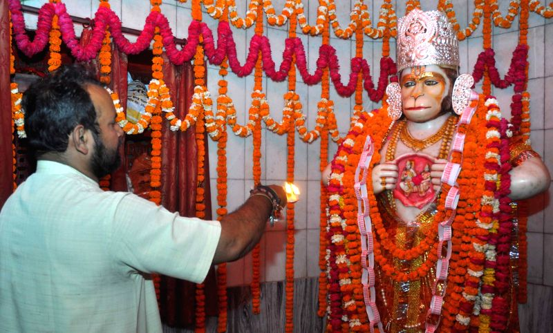 A priest performs aarti of an idol of Hanuman on the occation of Hanuman Jayanti in Lucknow on April 4, 2015.