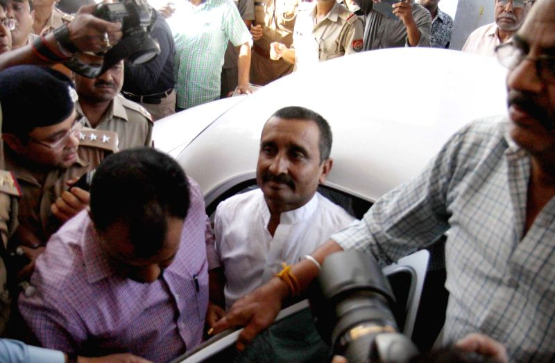 :Lucknow: BJP MLA Kuldeep Singh Sengar who is accused of raping a teenage girl arrives at a CBI court in Lucknow on April 14, 2018. (Photo: IANS).