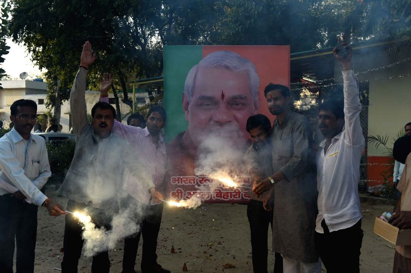 BJP workers stage a demonstration after President Pranab Mukherjee conferred Bharat Ratna to BJP leader and former prime minister Atal Bihari Vajpayee, in Lucknow on March 27, 2015. - Atal Bihari Vajpayee and Pranab Mukherjee