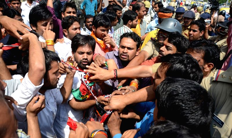 BJP workers  stage a demonstration against Uttar Pradesh Chief Minister Akhilesh Yadav in Lucknow on March 25, 2015. - Akhilesh Yadav