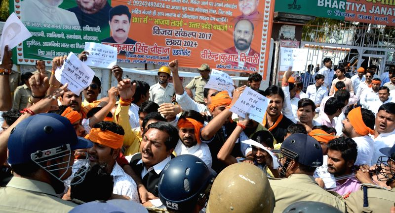 BJP workers stage a demonstration against Uttar Pradesh Government in Lucknow, on March 26, 2015.