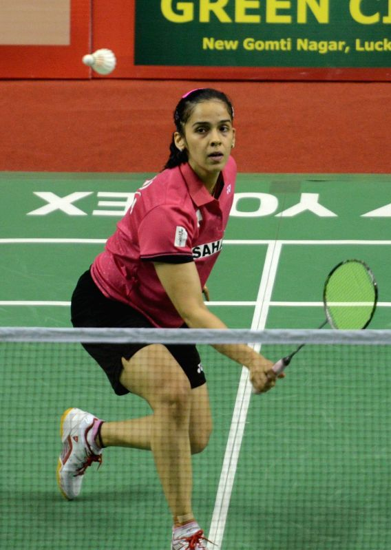 Indian shuttler Saina Nehwal in action during the  Syed Modi International Grand Prix Gold Badminton Championship in Lucknow, on Jan 21, 2015.