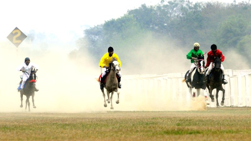 Jockeys participate in Presidents' Cup organised at the Lucknow Race Course on Feb 25, 2015.
