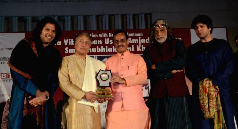 Lucknow mayor confers Naushad award on Sarod maestro Amjad Ali Khan during a programme on Nov 1, 2015. Also seen Amaan Ali Khan and Ayaan Ali Khan. - Amaan Ali Khan and Ayaan Ali Khan