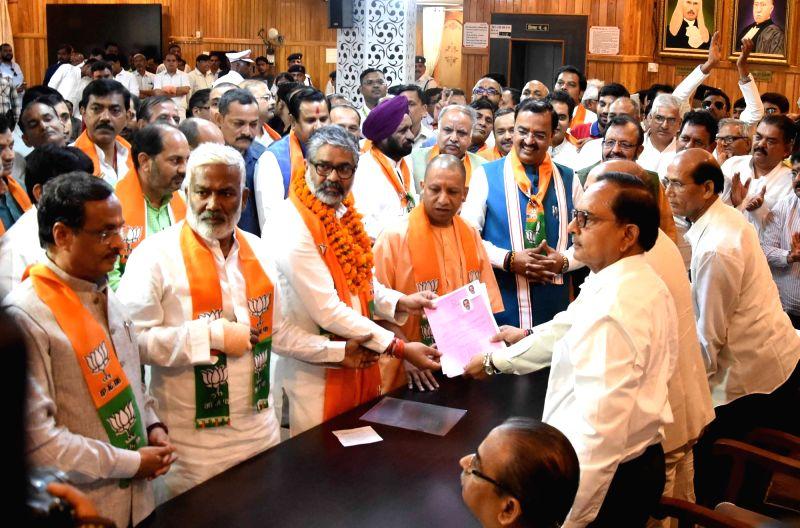 Lucknow: Neeraj Shekhar, son of former Prime Minister Chandra Shekhar, accompanied by Uttar Pradesh Chief Minister Yogi Adityanath, Deputy Chief Ministers Dinesh Sharma, Keshav Prasad Maurya and state BJP President Swatantra Dev Singh, files his nomi