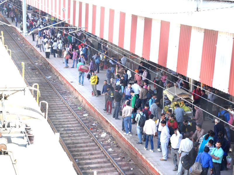 People headed towards their native places wait at a railway platform in Lucknow, on March 5, 2015.