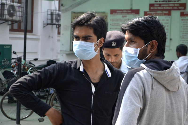People wear masks as a precautionary measure against swine flu in Lucknow, on Feb 25, 2015.