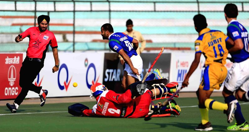 Players in action during a Hero Hockey India League 2015 match between Jaypee Punjab Warriors and Uttar Pradesh Wizards at Major Dhyan Chand Stadium in Lucknow, on Feb. 4, 2015. Uttar ...