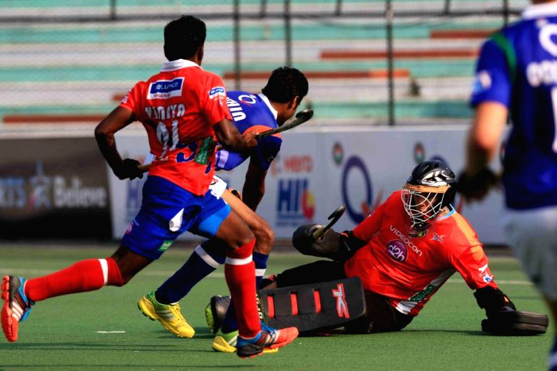 Players in action during a Hockey India League match between Uttar Pradesh Wizards and Dabang Mumbai in Lucknow, on Feb 15, 2015. (Photo : IANS)
