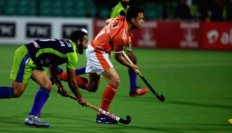 Players in action during a Hockey India League match between ​Kalinga Lancers and Delhi Waveriders in Lucknow, on Feb 15, 2015. (Photo : IANS)