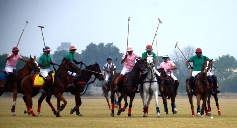 Players in action during Awadh Polo Cup Week organised by the Indian Army`s Central Command at the Surya Khel Parisar in Lucknow on Dec. 13, 2014.