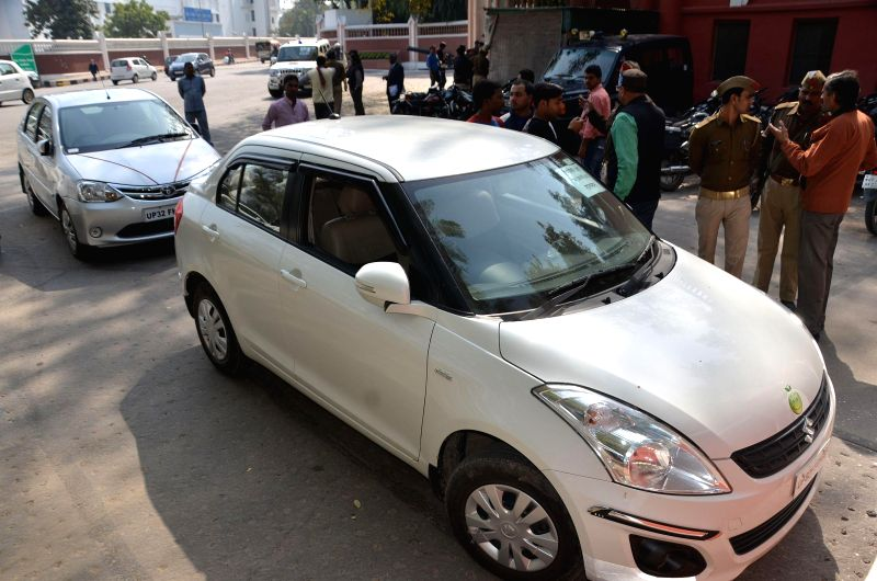 Policemen near a car that was intercepted as it tried to enter the official residence of the Uttar Pradesh governor with three crude bombs in the car in Lucknow, on Feb 14, 2015.
