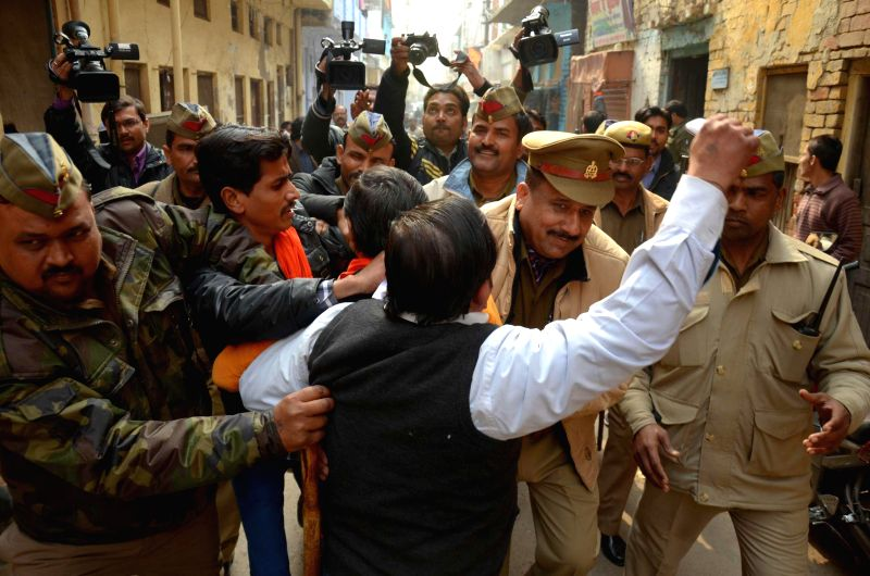 Policemen take away a person participating in `Nathuram Godse Janjagaran` rally organised by Hindu Mahasabha in Lucknow  on Jan 8, 2015.
