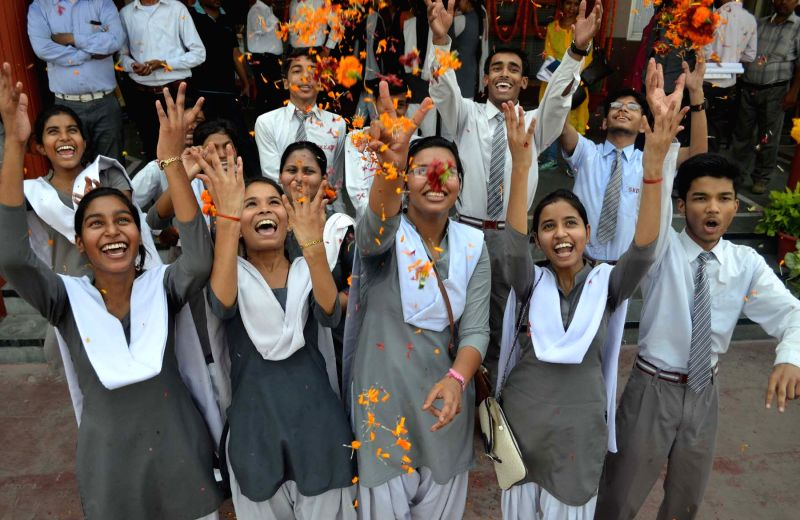 Lucknow : Students celebrate after declaration of results of UP Board Class X exams in Lucknow, on May 15, 2016.