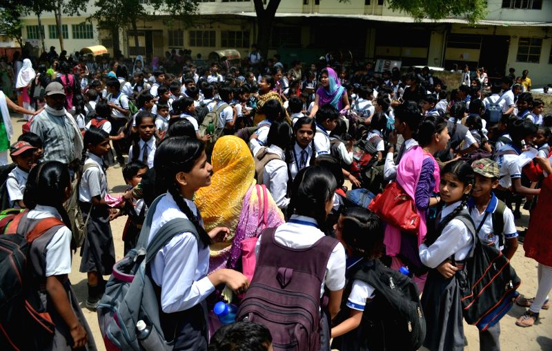 Students evacuated from a Lucknow school as tremors were felt in the city on April 25, 2015. According to the India Meteorological Department, the depth of earthquake was 10 km and measured ...