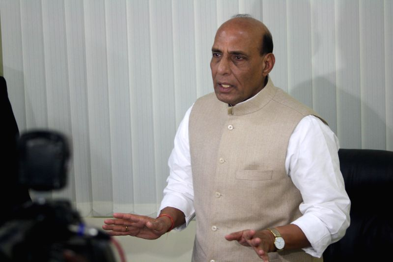 Union Home Minister Rajnath Singh interacts with journalists in Lucknow on Dec 1, 2014. - Rajnath Singh