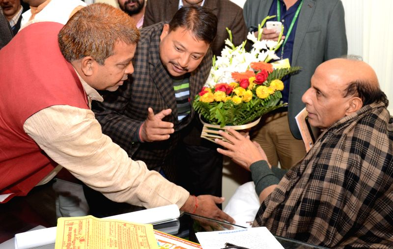 Union Home Minister Rajnath Singh being greeted at his residence in Lucknow, on Dec 26, 2014.