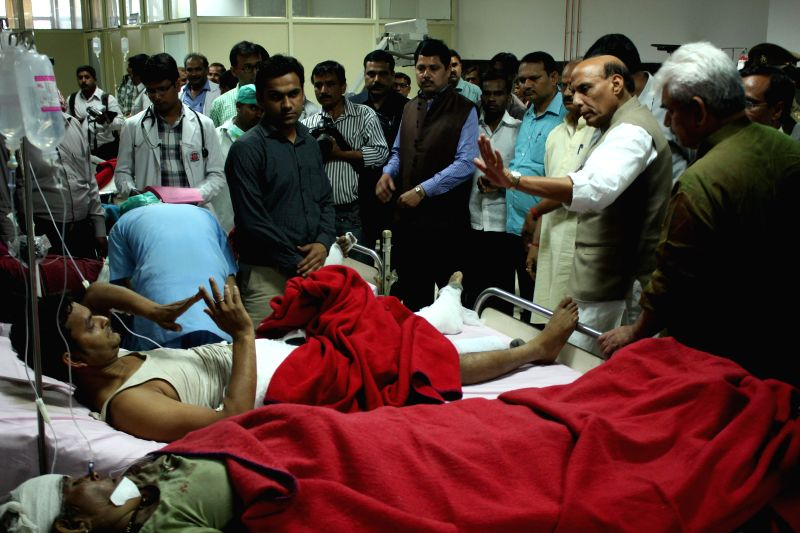 Union Home Minister Rajnath Singh meets the injured passengers of the derailed Dehradun-Varanasi Janta Express at a Lucknow hospital on March 20, 2015.
