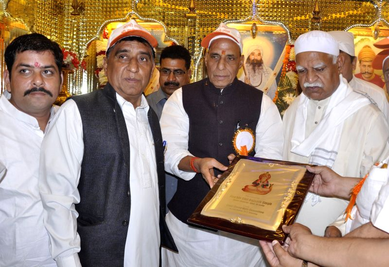 Union Home Minister Rajnath Singh pays obeisance at a temple in Lucknow on March 21, 2015.
