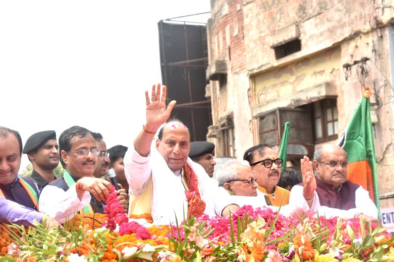 Lucknow: Union Minister and BJP's Lok Sabha candidate from Lucknow, Rajnath Singh with Uttar Pradesh Deputy Chief Minister Dinesh Sharma and BJP state President Mahendra Nath Pandey, during a roadshow ahead of filing his nomination papers for the for