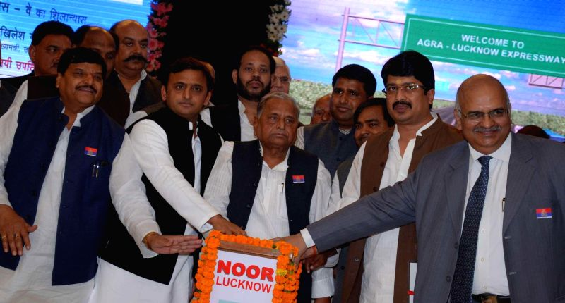 Uttar Pradesh Chief Minister Akhilesh Yadav, Samajwadi Party chief Mulayam Singh Yadav and others at a programme organised to lay the foundation stone of Agra-Lucknow expressway in Lucknow, . - Akhilesh Yadav and Mulayam Singh Yadav