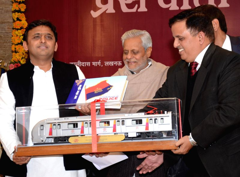 Uttar Pradesh Chief Minister Akhilesh Yadav with a model of a metro coach during a programme organised after Uttar Pradesh cabinet okayed the detailed project reports (DPRs) for metro rail .. - Akhilesh Yadav