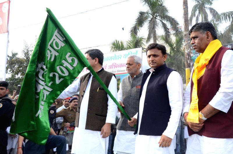 Uttar Pradesh Chief Minister Akhilesh Yadav flags-off Samajwadi Shrawan Yatra train from Lucknow on March 14, 2015. Samajwadi Shrawan Yatra is a free of cost religious pilgrimage for senior ... - Akhilesh Yadav