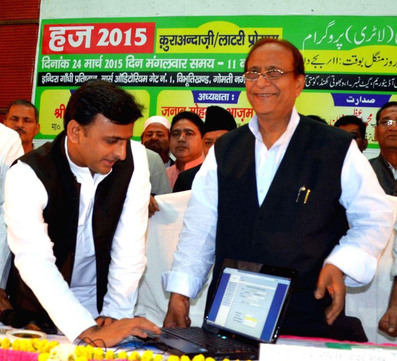 Uttar Pradesh Chief Minister Akhilesh Yadav  and Uttar Pradesh cabinet minister Azam Khan during Haj lottery programme organised in Lucknow, on March 24, 2015. - Akhilesh Yadav and Azam Khan