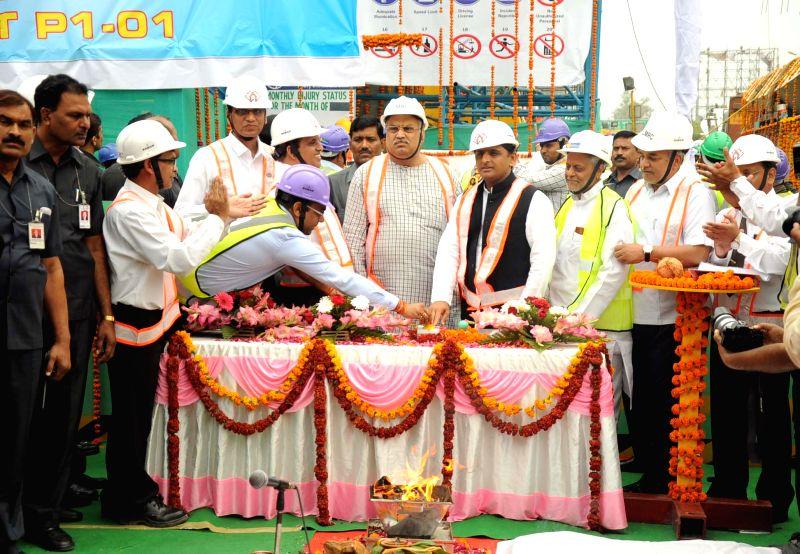Uttar Pradesh Chief Minister Akhilesh Yadav lays the foundation stone for Lucknow Metro on April 12, 2015.