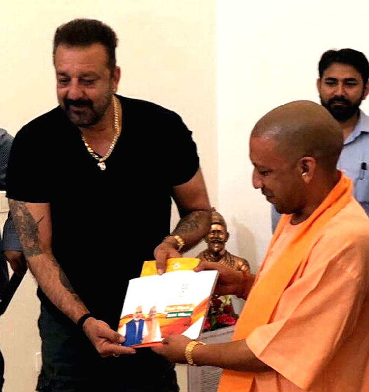 : Lucknow: Uttar Pradesh Chief Minister Yogi Adityanath meets actor Sanjay Dutt at his residence in Lucknow on June 9, 2018. (Photo: IANS).